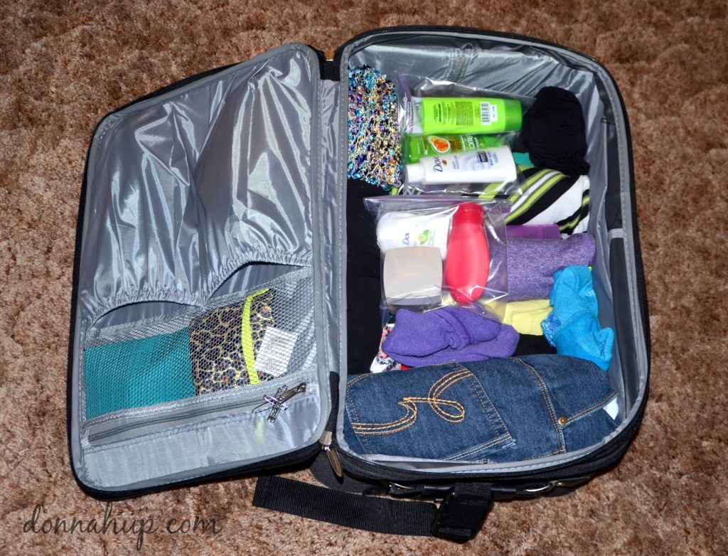Neatly packed and organized carry on suitcase.